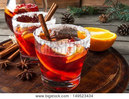 Fragrant autumn and winter sangria with oranges, apples, cranberries and spices, copy space