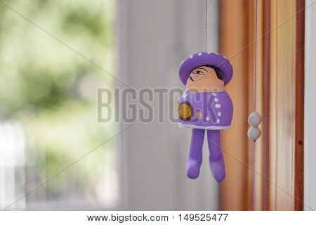 String puppet decoration on a bright room