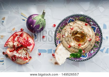 Traditional Arabian Eggplant Dip Baba Ganoush With Herbs And Smoked Paprika On A Mosaic Background