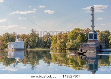 Chesme column surrounded by gorgeous lake in Catherine park. Golden autumn in Pushkin, Tsarskoe Selo, St. Petersburg, Russia