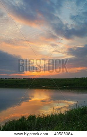 Beautiful sunset on the river vertical background