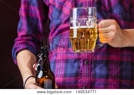 Man Holds Glass Of Beer.