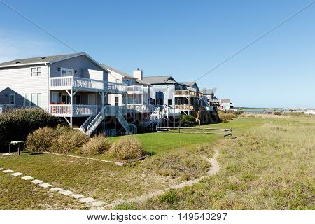 Luxury beach vacation rental houses on the green sand dunes; Sunset Beach, North Carolina