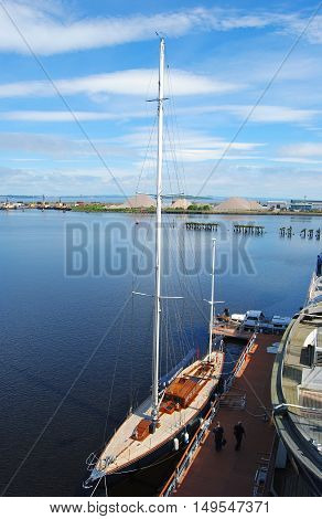 Edinburgh, United Kingdom - June 16, 2014. The 1930s racing yacht Bloodhound which was owned by the Queen in the 1960s is now moored alongside Royal Yacht Britannia in Edinburgh, with people.