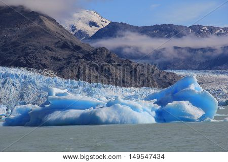 Blue iceberg and clouds in El Calafate Patagonia Argentina