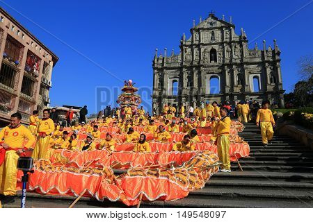 MACAU MACAU - FEBRUARY 07, 2016 - Ruins Of Saint Paul's Cathedral during the celebration of the chinese new year. Dragon Dances for Chinese New Year.