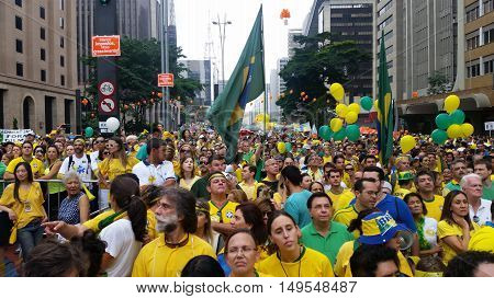 SAO PAULO SP BRAZIL - MARCH 13 2016: Massive anti-government protests at Paulista Avenue. Brazilians return to streets to call for President Dilma Rousseff's exit.