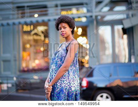 Portrait of fashionable black woman on city street. Photographed in Soho NYC.