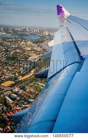 Sydney, Australia - Dec 23, 2015: Onboard Hawaiian Airlines. The plane descends and banks slightly to reveal the harbor and surrounding suburbs.
