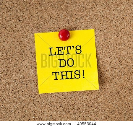 The phrase Let's Do This in red text on a yellow sticky note posted on a cork notice board
