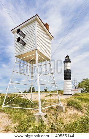 The Big Sable Point Lighthouse in Michigan's Ludington State Park is accompanied by a foghorn tower.