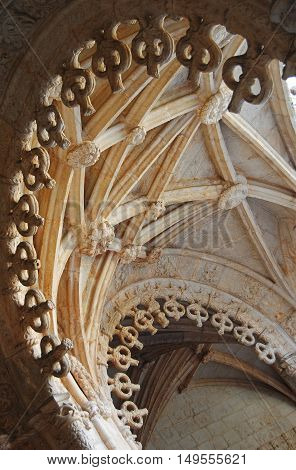 Lisbon, Portugal - October 21, 2014. Delicately scalloped arches of Manueline cloisters of Mosteiro des Jeronimos in Lisbon.