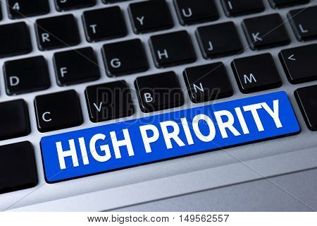 HIGH PRIORITY a message on keyboard  business man hard work