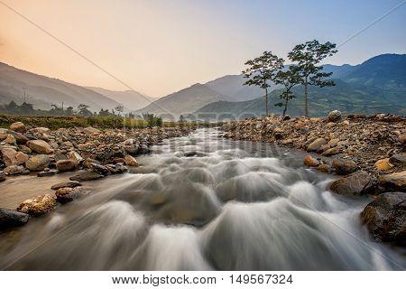 River in Tu le scenic streams fields of grain side highland Tu le Yen Bai Vietnam