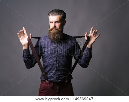 Trendy Man Pulls Suspenders