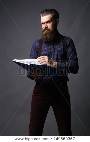 Handsome Man Reads Journal