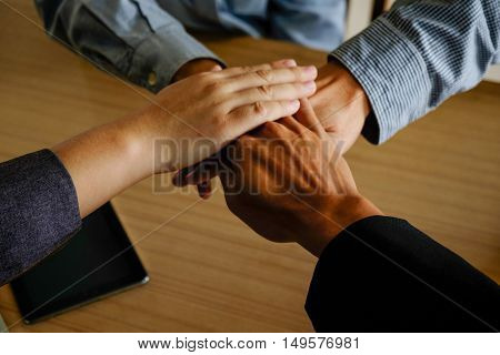 Business teamwork standing hands together in the office with copy space. Business people joining hands together.People Teamwork hands. togetherteamwork online.business teamworkjoin hands together