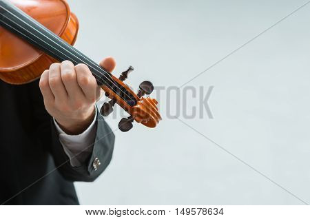 Talented violinist and classical music player solo performance blank copy space on the right
