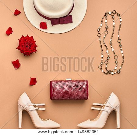 Fashion Lady Accessories Set. Fashion Stylish Handbag Clutch, Glamor Heels, Hat, Rose. Trendy fashion Design. Top view. Fall Fashion. Woman Outfit. Vintage. Elegant Creative Overhead. Minimal Concept