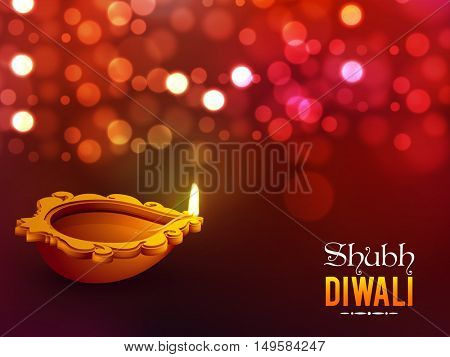 Creative illuminated oil lamp (Diya) on red defocused background for Shubh Diwali (Happy Diwali) celebration.