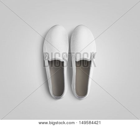 Blank white slip-on shoes pair design mockup top view clipping path 3d rendering. Plain hipster slipon mock up template stand from above. Urban skate boot with clear insole presentation.