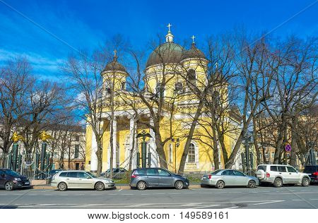The facade of the Transfiguration Cathedral with massive portico tall columns and four bell towers located in the same named square in St Petersburg Russia.
