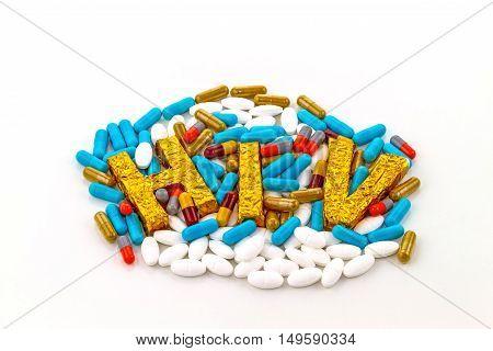 A word HIV on pill lie strewn background
