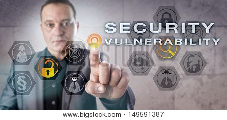 Mature male investigator is identifying a SECURITY VULNERABILITY onscreen. Information technology concept for computer security exploits reduction of information assurance and hacking attacks.