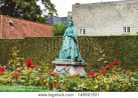 September, 22th, 2015 - Copenhagen, Denmark. Queen Caroline Amalie of Augustenburg statue in rose Garden near Rosenborg Castle.