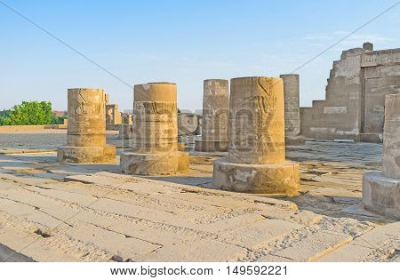 The ruined columns at the entrance to the ancient Kom Ombo Temple located in the same named town Egypt.