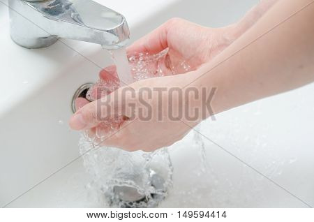 Woman washing hands with water , no soap