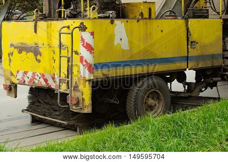 detail of a street sweeper machine car cleaning the road.