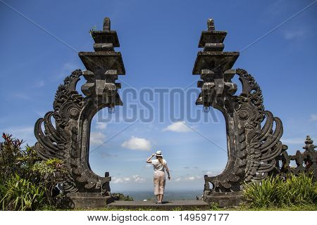 young woman at Besakih temples in Bali Indonesia