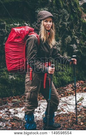 Woman Hiker with red backpack traveling Lifestyle adventure survival concept outdoor rainy moody weather