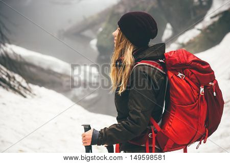 Woman Traveler with backpack hiking Travel Lifestyle adventure concept active vacations outdoor snow forest on background