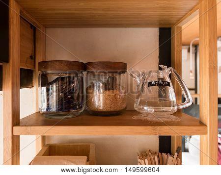 Set of sugar in glass bottle in self-service cafe