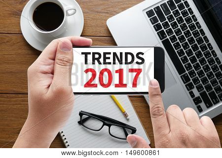 TRENDS 2017  businessman work hard  hand touch