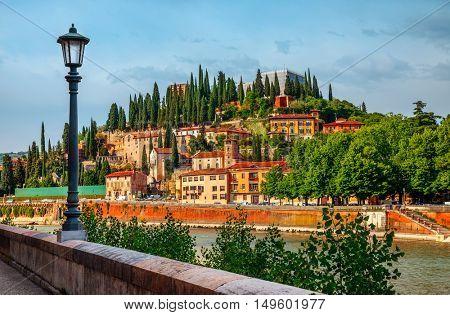 Italy Verona old italian house on knoll panorama with bank river Adige embankment street lamp