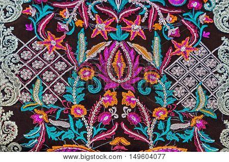 Background with material embroidered with specific patterns of the Bistrita-Nasaud area Romania.