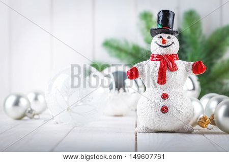 Christmas happy snowman with glass balls decoration for firtree greeting card wooden white board copyspace