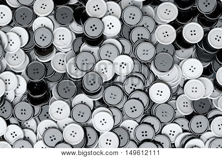 Sewing Buttons background. Black and White Sewing Buttons extreme closeup. 3d Rendering