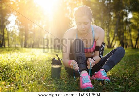 Woman Lacing Running Shoes Before Workout.