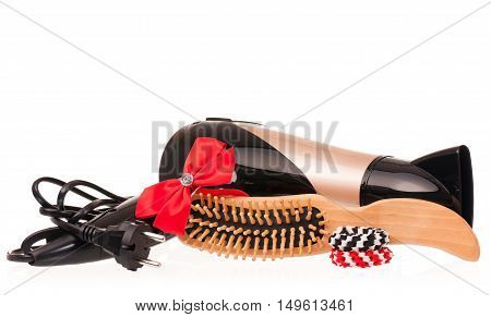 Hair dryer with hair accessories isolated on white background