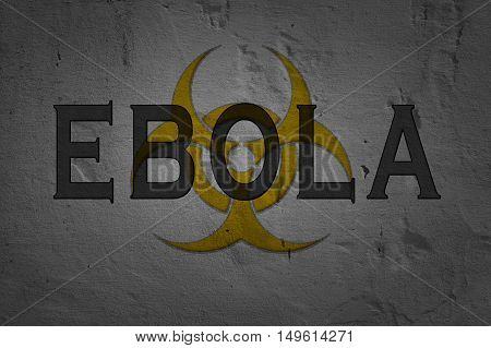 Word Ebola isolated on dark background with biohazard sign.