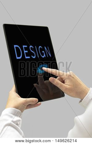 Design message on digital tablet computer display. Woman hands with tablet computer. Selective focus.