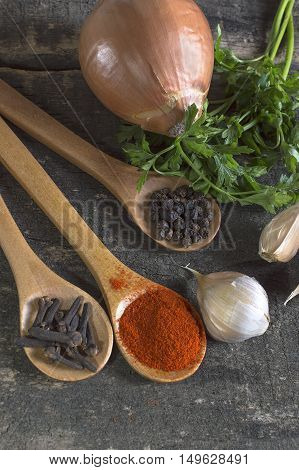 Various kinds of spices on wooden planks. Shallow depth of field