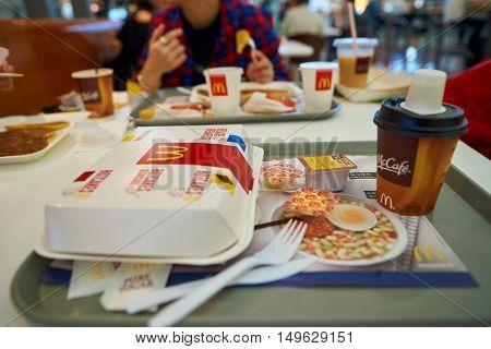 HONG KONG - CIRCA SEPTEMBER, 2016: a tray of food from McDonald's in Hong Kong International Airport. McDonald's is the world's largest chain of hamburger fast food restaurants.