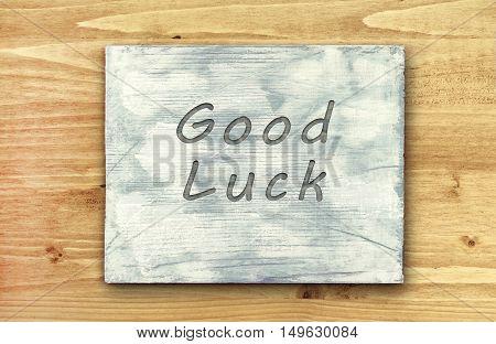 Vintage hipster motivational phrase note Good Luck sign.