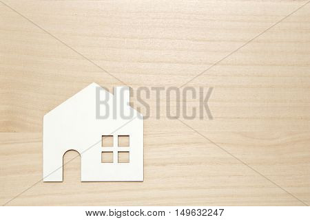 Miniature white house on wood. New house concept.