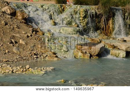 Thermal hot springs in Saturnia Italy with waterfalls